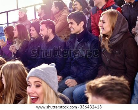 Sport fans clapping and crying on tribunes. Group people. - stock photo
