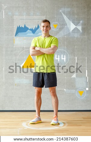 sport, fitness, lifestyle and people concept - smiling man in gym - stock photo