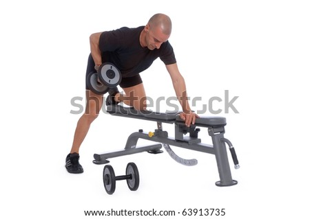 Sport Fitness trainer exercising in a table using dumbbells in gym, isolated over white background - stock photo