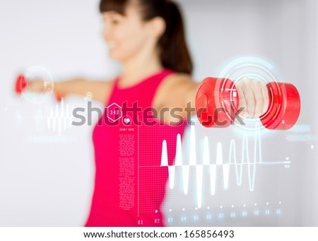 sport, fitness, training and happiness concept - sporty woman hands with light red dumbbells - stock photo