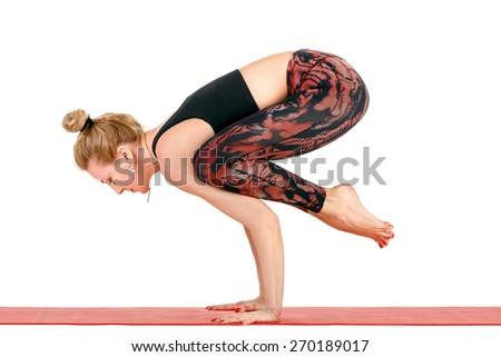 Sport fitness woman doing yoga exercises, hand balance, full length portrait isolated over white background - stock photo