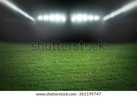 Sport football stadium in spotlights - stock photo