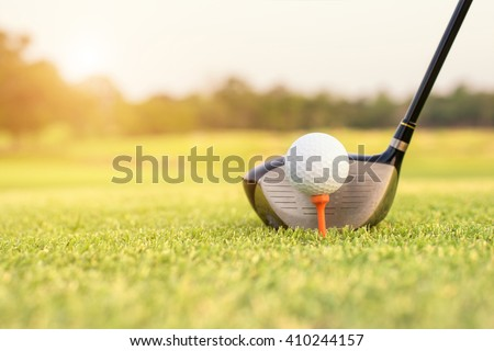 Sport, Golf concept - Golf club and ball in grass. Close up at golf club and golf ball.  - stock photo