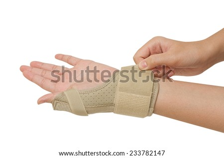 Sport injury, wrist with  brace support release pain - stock photo