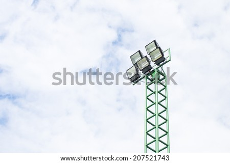 Sport light with blue sky and white cloud. - stock photo