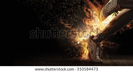 Sport. Runner. Side view of a jogger legs with the power in the veins  isolated on black. Fire and energy - stock photo