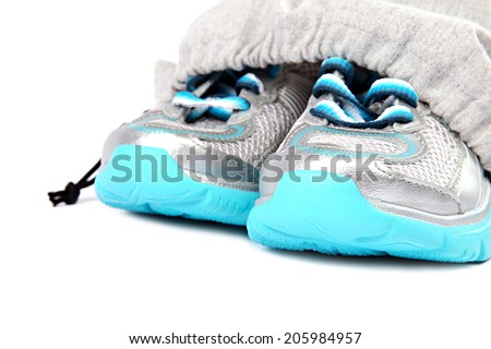 Sport shoes in bag isolated on a white background. - stock photo