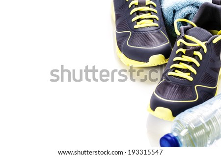 Sport shoes, measuring type and water on white background - stock photo