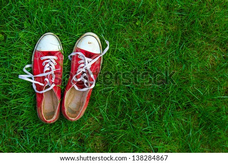 sport shoes on grass background - stock photo