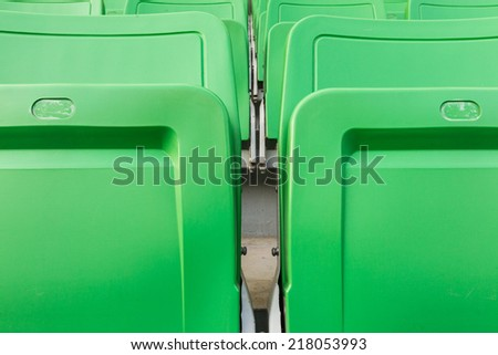Sport stadium Plastic chairs in a row. - stock photo