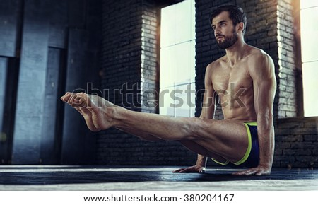 Sport. Strong young athlete doing  exercise. Handstand - stock photo