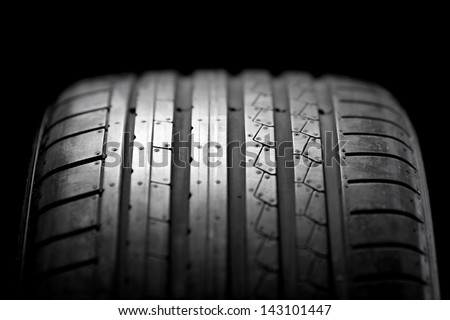 Sport summer tire isolated on black background - stock photo