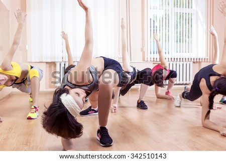 Sport, Training anf Healthy Lifestyle Concepts. Group of Caucasian Women Taking Part In Gym Fitness Class. Horizontal Image Orientation - stock photo