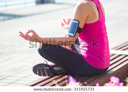 Sport woman having relax during training outside in city quay in the morning - stock photo