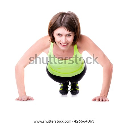 sport woman pressing-up off the floor isolated on white background - stock photo