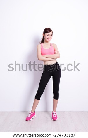 Sport Woman with health figure with white wall background, great for your design or text, asian beauty - stock photo