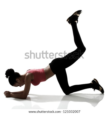 sport young athletic woman doing legs exercise, active fitness girl silhouette studio shot over white - stock photo