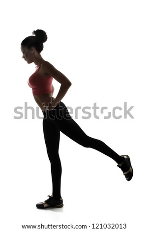 sport young athletic woman doing legs exercise, active fitness girl silhouette studio shot over white background - stock photo