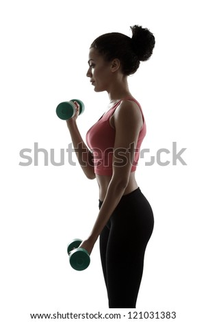 sport young woman doing exercise with dumbbells, fitness girl silhouette studio shot over white background - stock photo