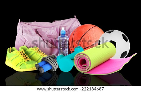 Sporting goods on black background - stock photo