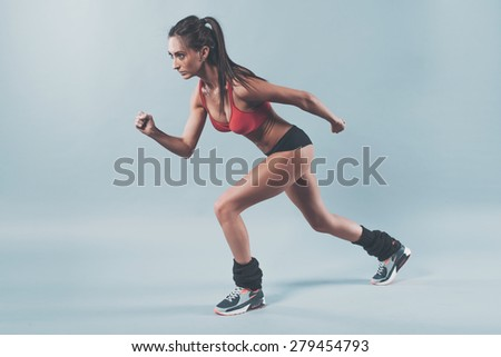 Sportive athlete woman sprinter waiting for the start running position fitness, sport, training and lifestyle concept. - stock photo