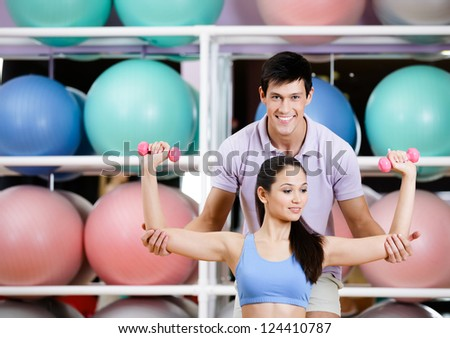Sportive girl exercises in fitness gym with couch - stock photo