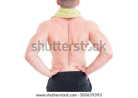 Sportive man holding his lumbar area or lower back after injury and pain - stock photo