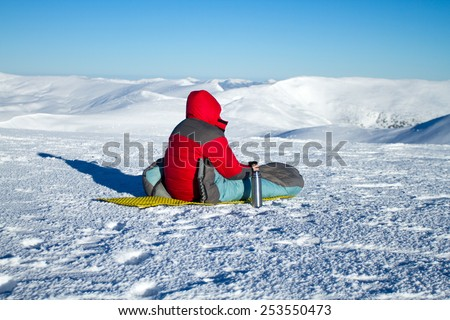 sportive man on the mountain trek, man sit and rest - stock photo