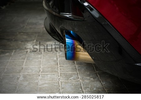 Sportive mufflers. Round Car Exhaust Pipe chromed made of stainless steel with flame burned tail - stock photo