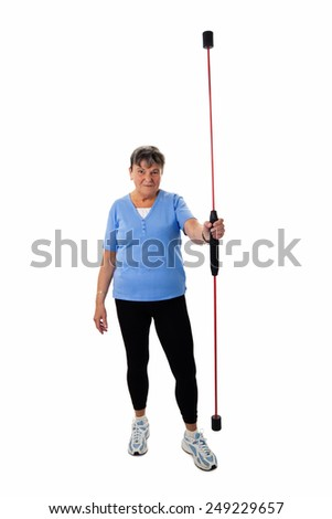 Sportive senior woman with swing stick - isolated - stock photo