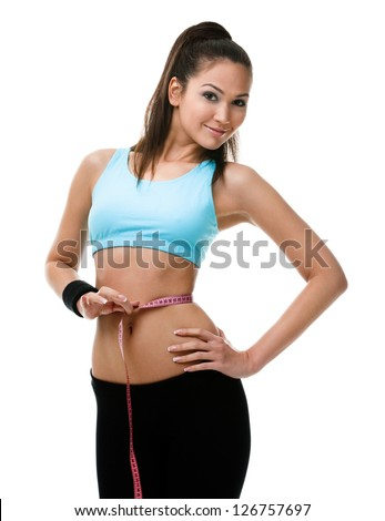 Sportive woman measures her waist with  	measuring tape, isolated on white - stock photo