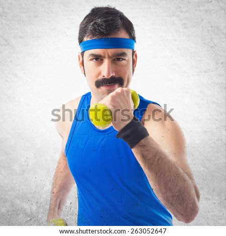 Sportman running with weightlifting  - stock photo