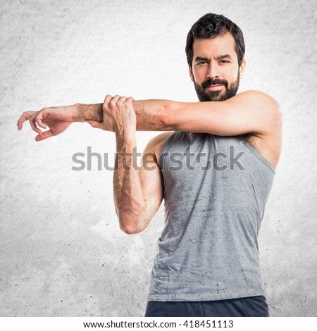 Sportman stretching arms - stock photo