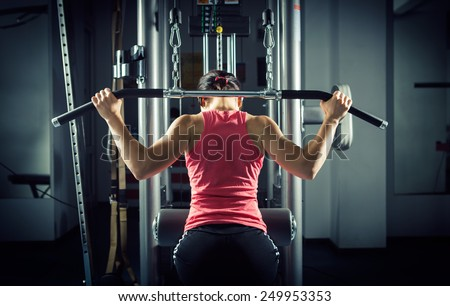 Sports background. Muscular fit woman exercising.  - stock photo