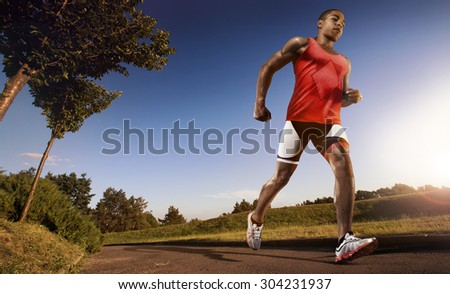 Sports background. Running athlete man. - stock photo