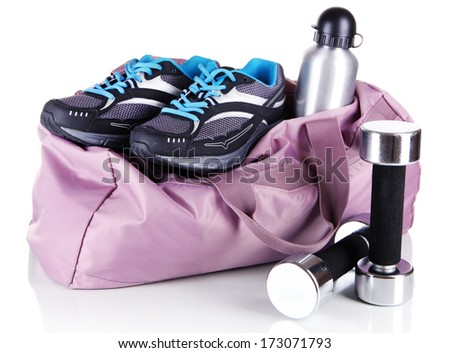 Sports bag with sports equipment isolated on white - stock photo