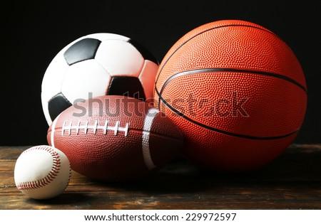 Sports balls on black background - stock photo