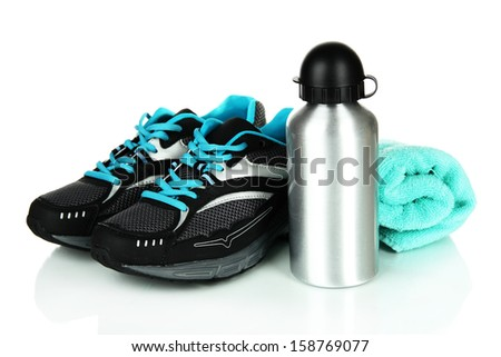 Sports bottle,sneakers and towel isolated on white - stock photo