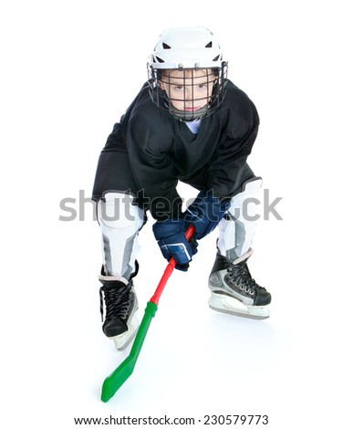 Sports development, training hockey, happy childhood concept.Little boy learning to play hockey. - stock photo