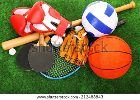 Sports equipment on grass background - stock photo