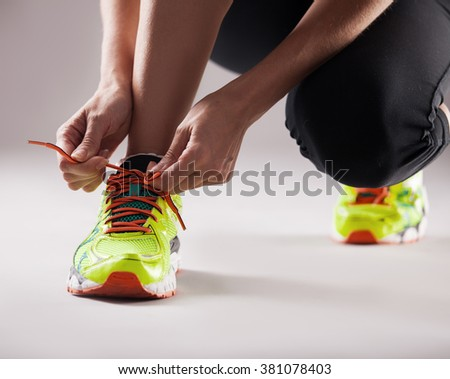 Sports. Girl tying shoelaces. Fitness - stock photo