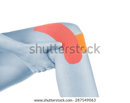Sports injury - woman having pain in his knee making massage. - stock photo
