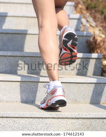 sports legs running/climbing on mountain stairs  - stock photo