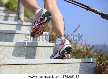 sports legs running/move up on mountain stairs  - stock photo