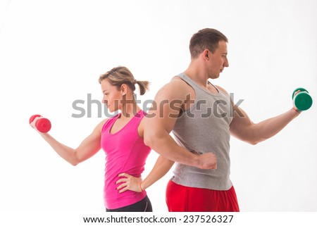 Sports man and woman posing on a white background. Athletic couple in sportswear. Fitness, sports, good shape, the pair - the concept of family fitness. - stock photo