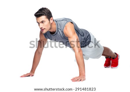 Sports man doing push ups isolated on a white background - stock photo