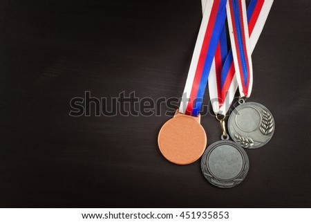 Sports medals on a wooden background. Collection of medals for the winners. Awards in sports.  - stock photo