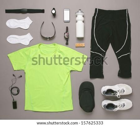 Sports set./ Running equipment man on grey background.  - stock photo