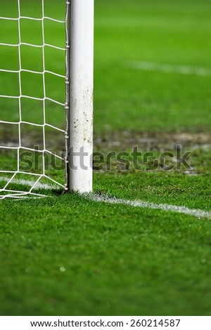 Sports shot with a soccer goal detail on rainy day  - stock photo