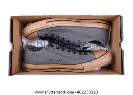 sports sneakers in the box, stylish shoes isolated on white - stock photo